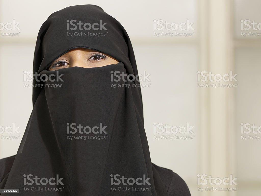 Woman wearing a burkha royalty-free stock photo
