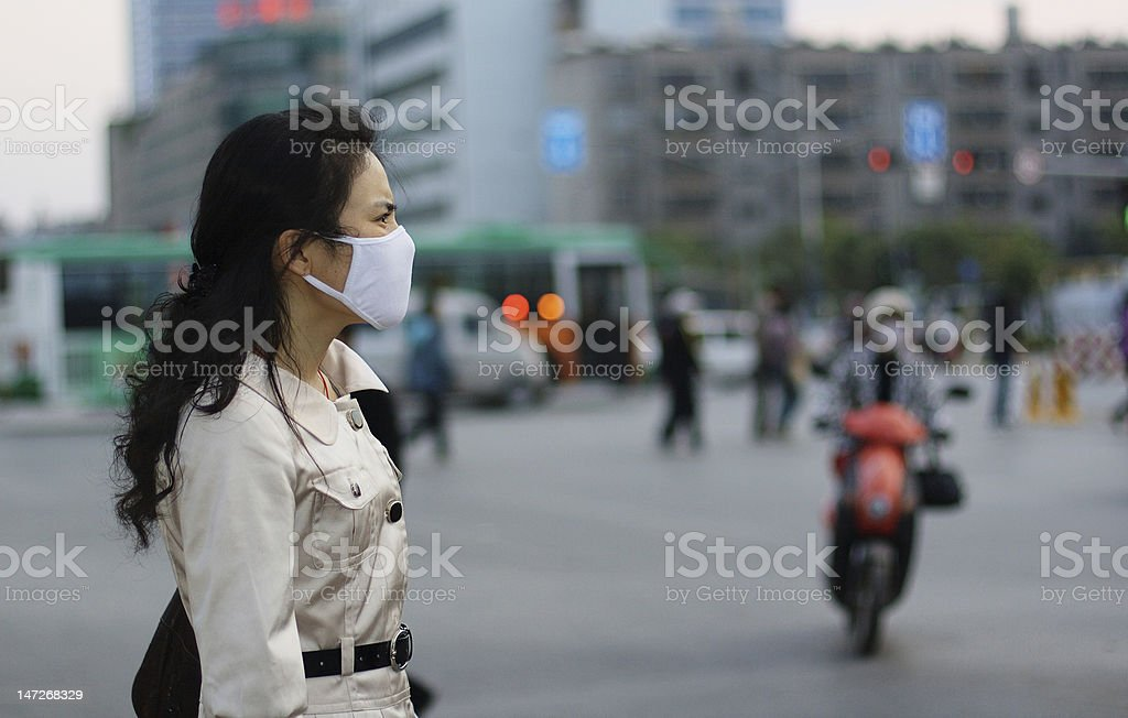Woman wearing a face mask against pollution or disease royalty-free stock photo