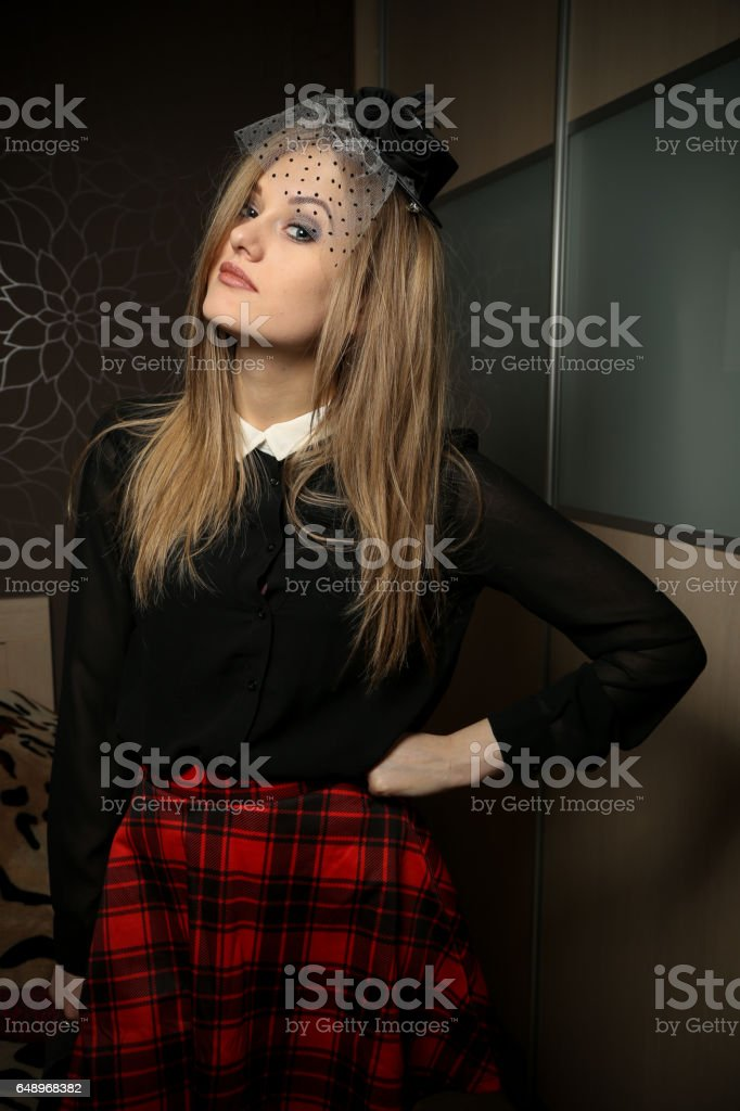 Woman wearing a fascinator stock photo