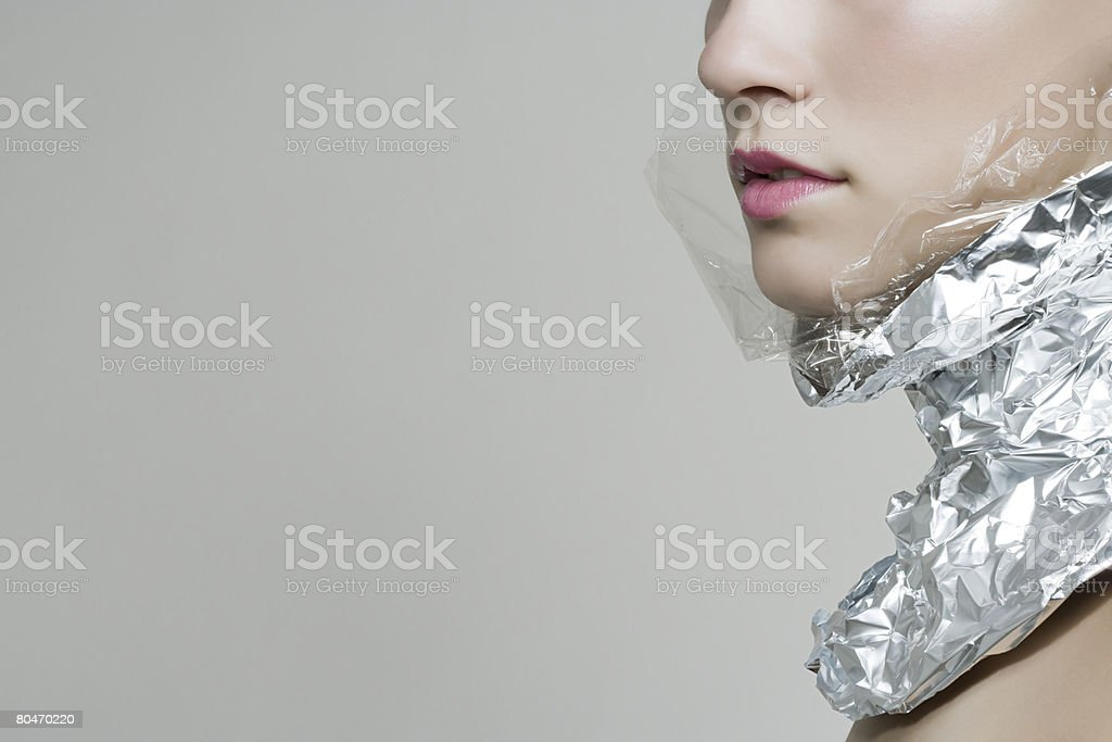 A woman wearing a foil collar royalty-free stock photo