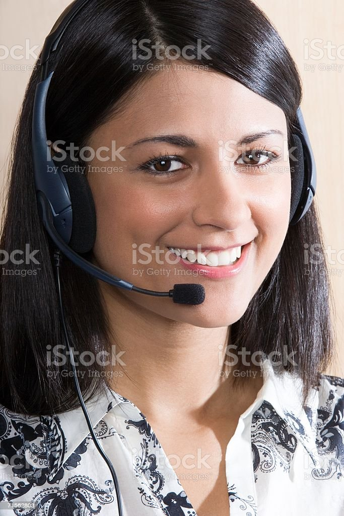 Woman wearing a headset royalty-free stock photo