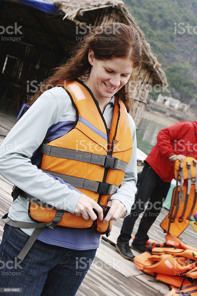 Woman wearing a life jacket royalty-free stock photo