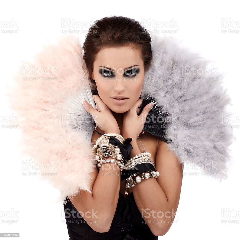 Woman wearing a lot of bracelets and holding feather fans royalty-free stock photo