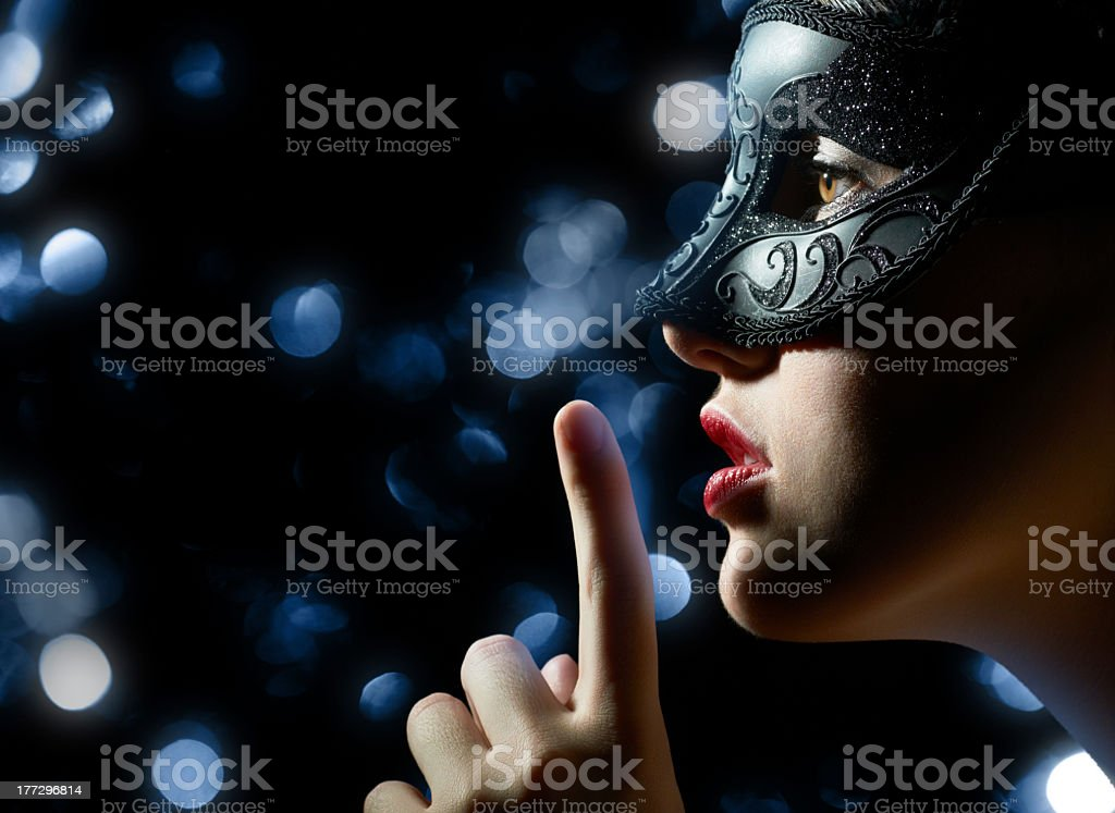 Woman wearing a mask and asking for silence royalty-free stock photo