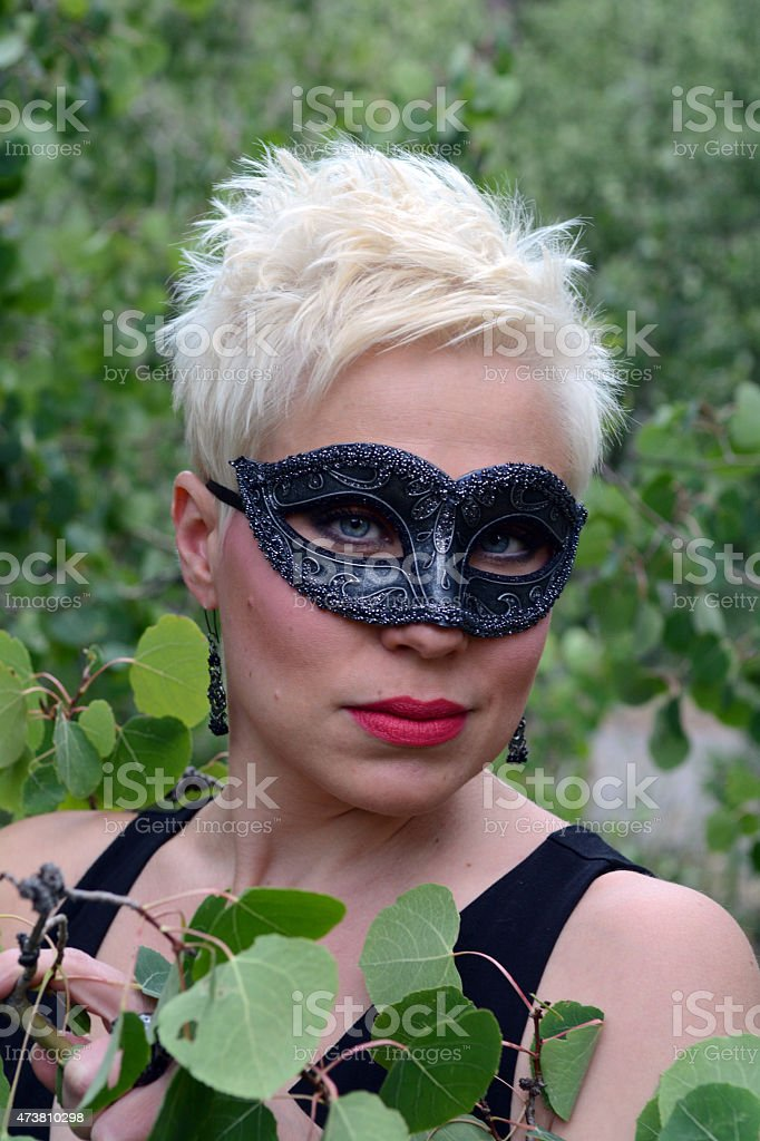 Woman Wearing a Mask in the Woods royalty-free stock photo