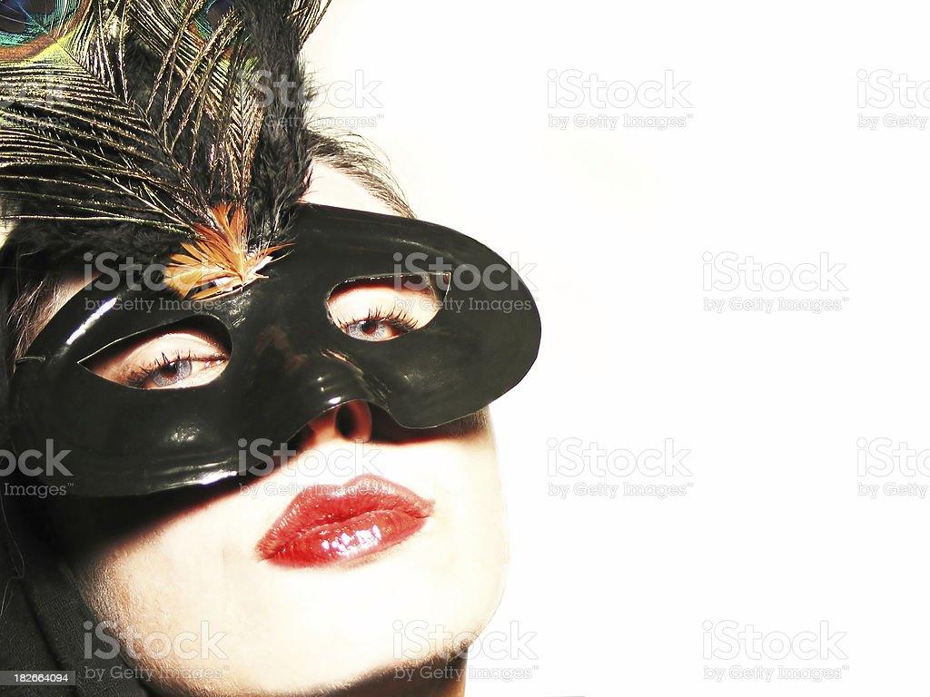 Woman wearing a masquerade mask royalty-free stock photo