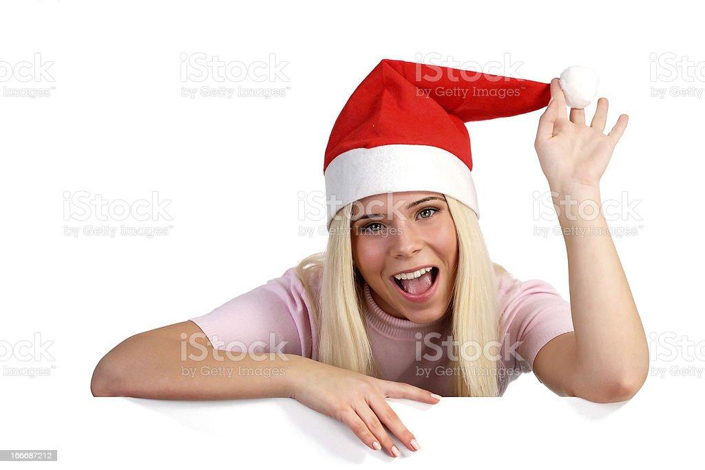 Woman wearing a Santa hat royalty-free stock photo
