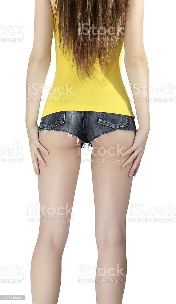 woman wearing a short jeans shorts with yellow tank top stock photo