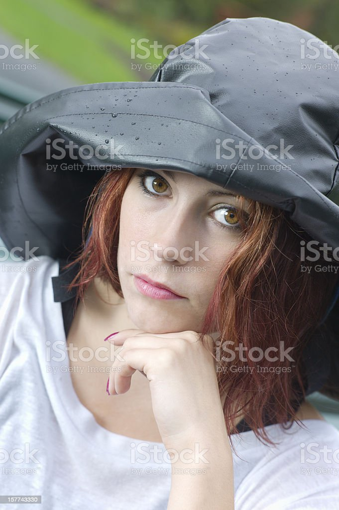 Woman Wearing a Sou'wester Fisherman's Hat in the Rain. royalty-free stock photo