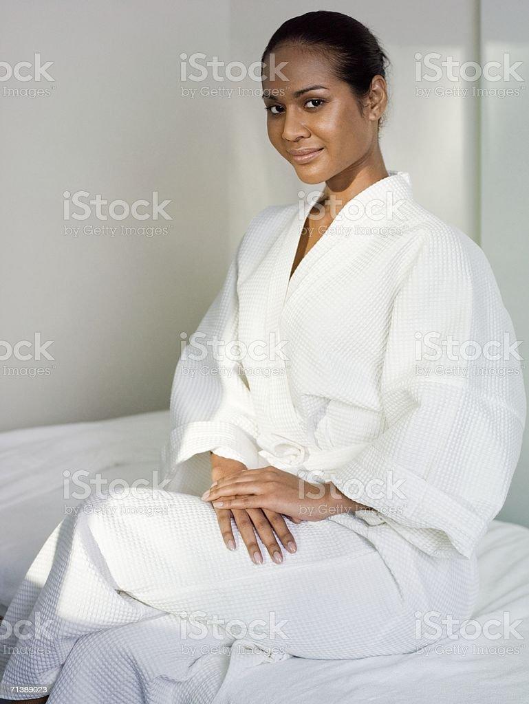 Woman wearing a spa robe stock photo