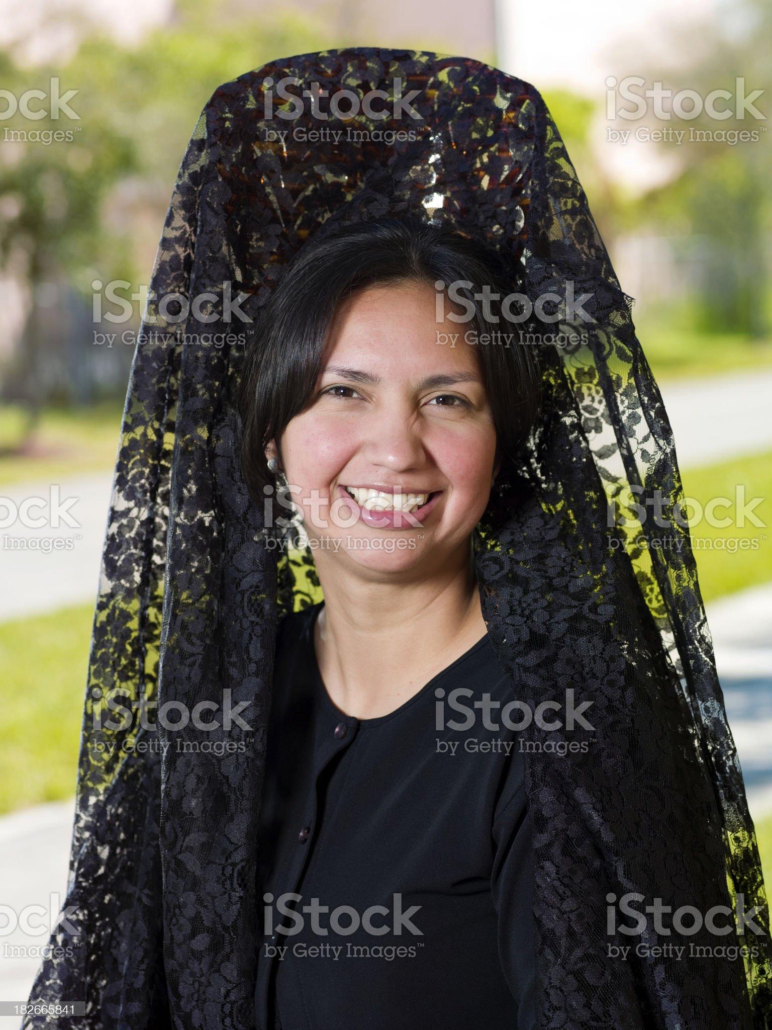Woman wearing a Spanish Mantilla (headscarf) royalty-free stock photo