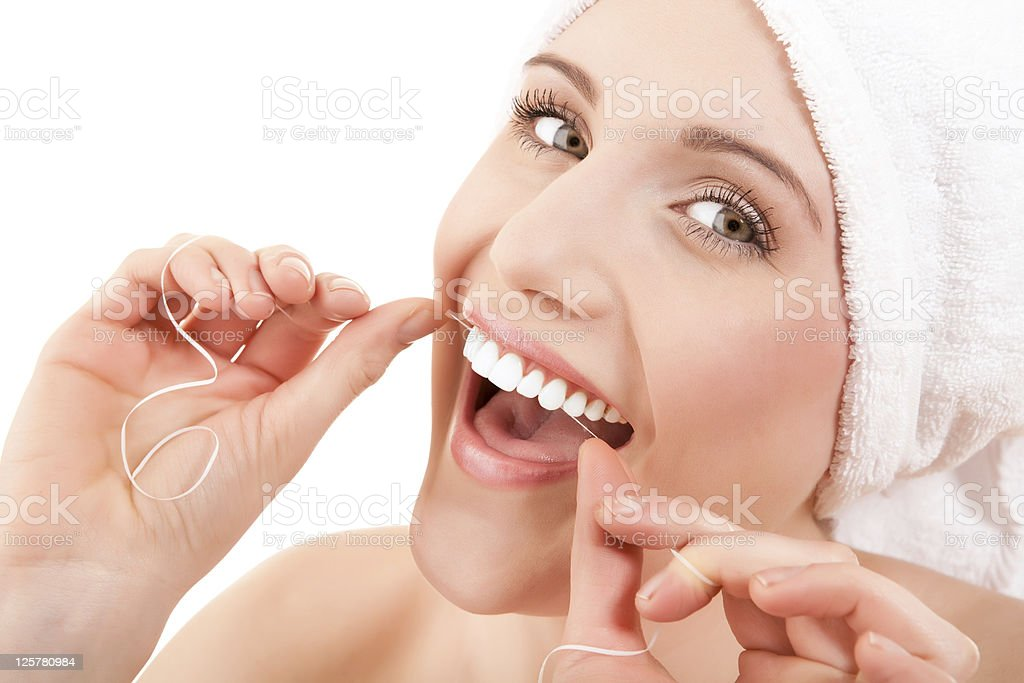 Woman wearing a towel flossing royalty-free stock photo