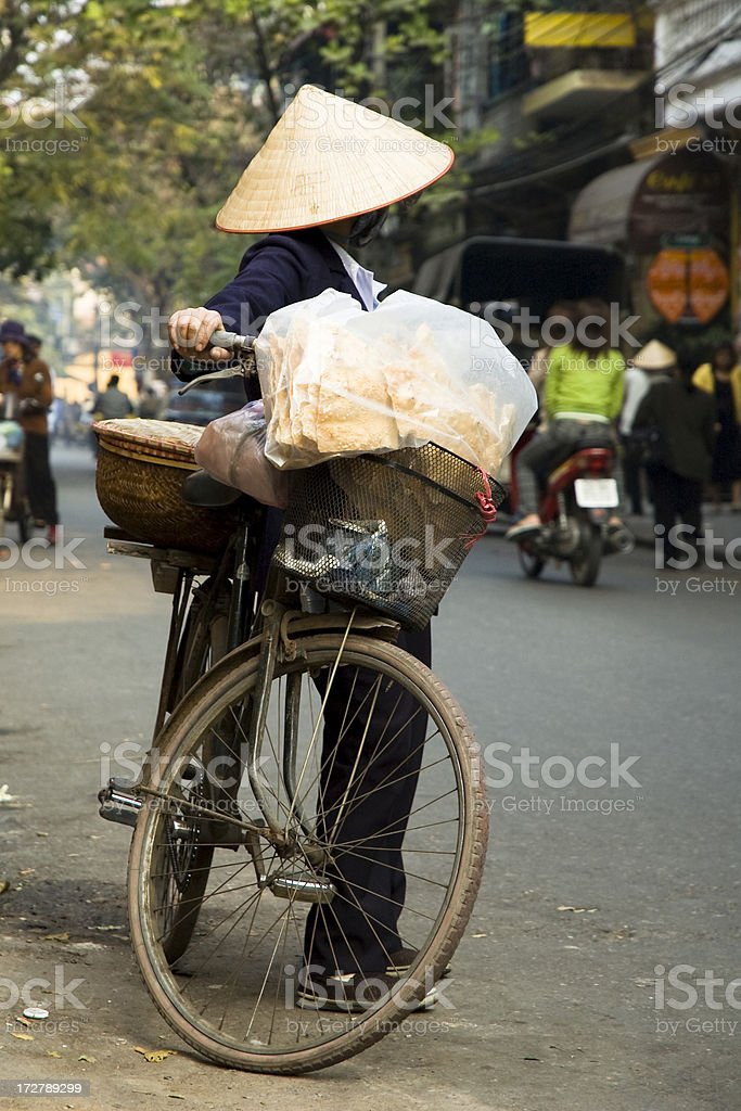 Woman Wearing A Traditional Conical Hat In Hanoi, Vietnam stock photo