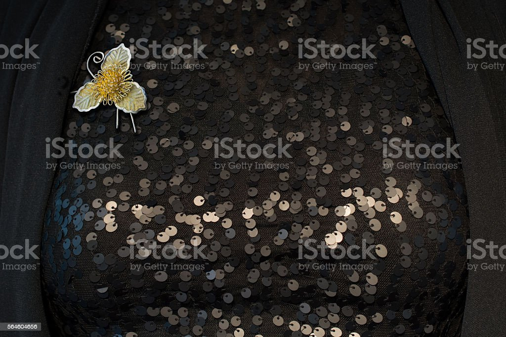 Woman wearing a vintage three leafed golden brooch stock photo
