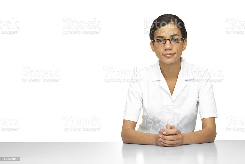 Woman wearing a white lab coat and glasses royalty-free stock photo