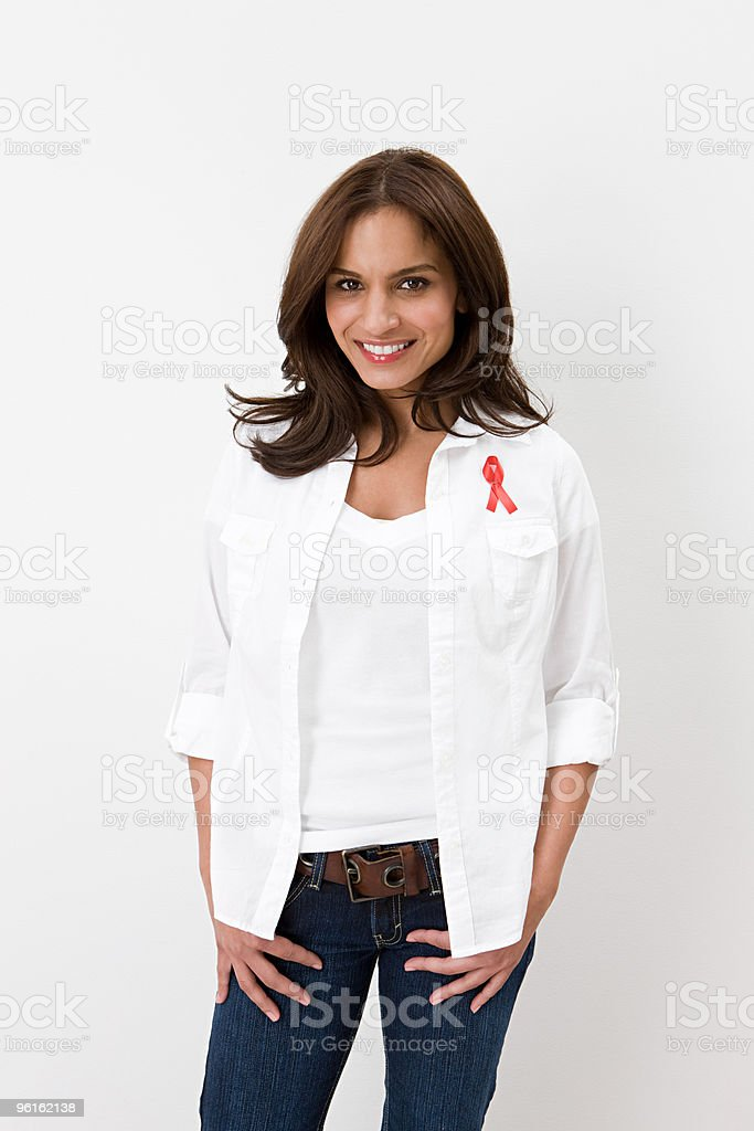 Woman wearing aids awareness ribbon stock photo