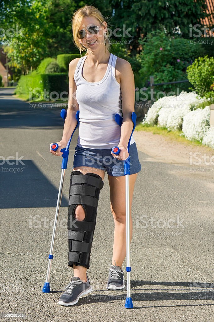 Woman wearing an orthopaedic leg brace. stock photo