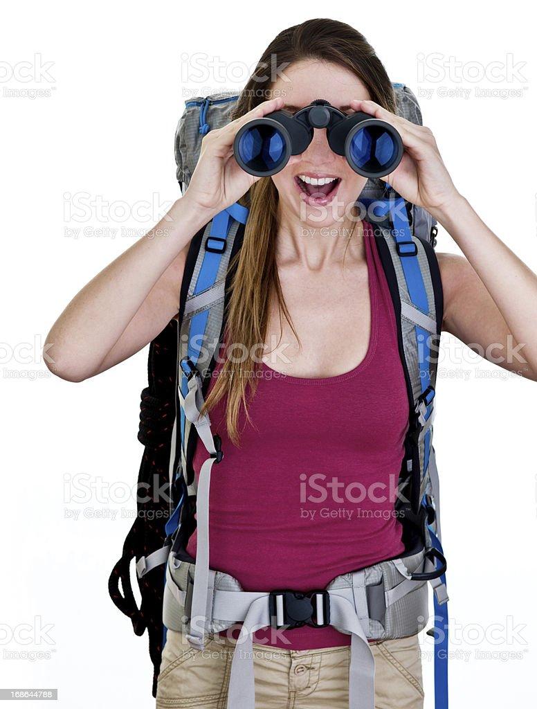 Woman wearing  backpack and looking through binoculars royalty-free stock photo