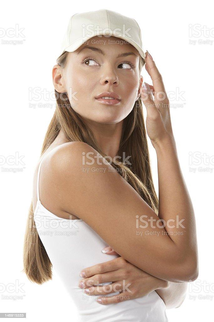 Woman wearing baseball cap stock photo