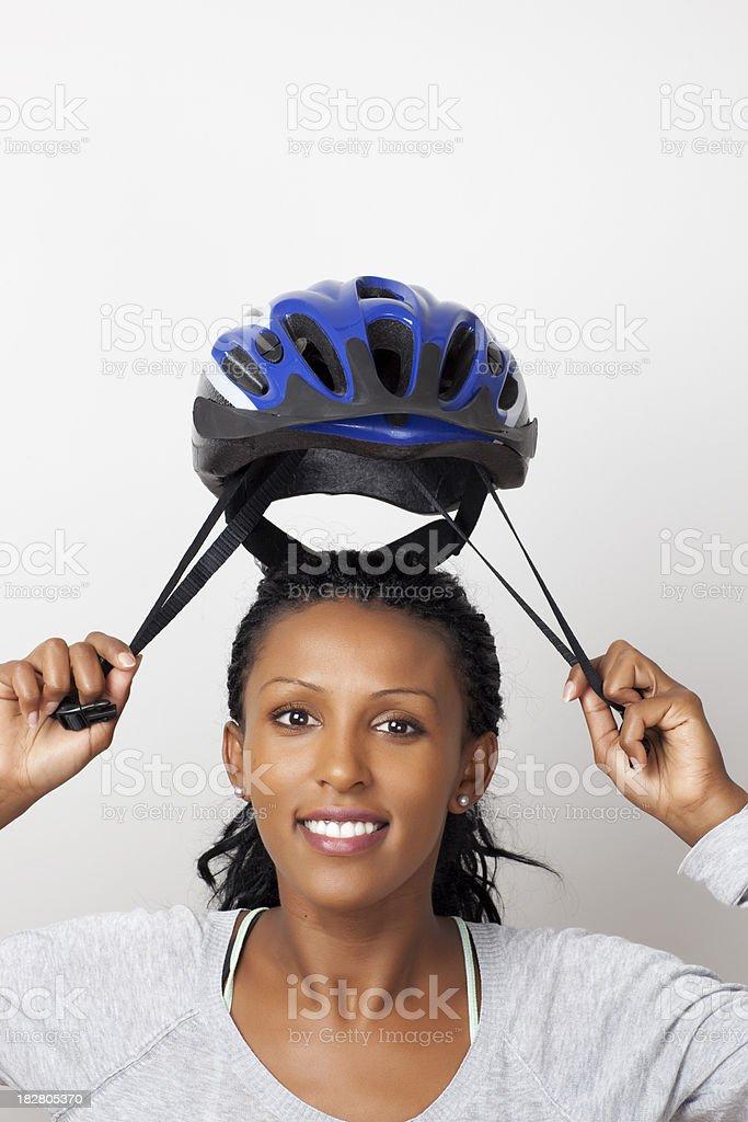 Woman wearing bicycle helmet. royalty-free stock photo