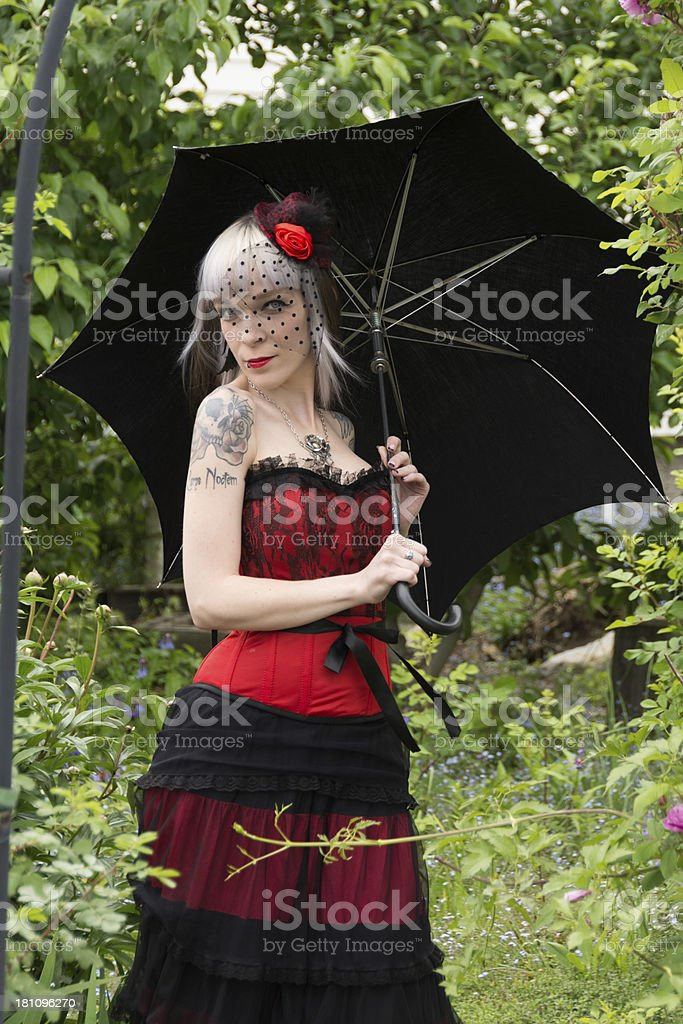 Woman wearing black and red flirting in garden. royalty-free stock photo