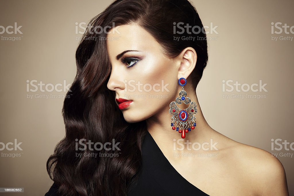 Woman wearing black dress and stylish earrings stock photo