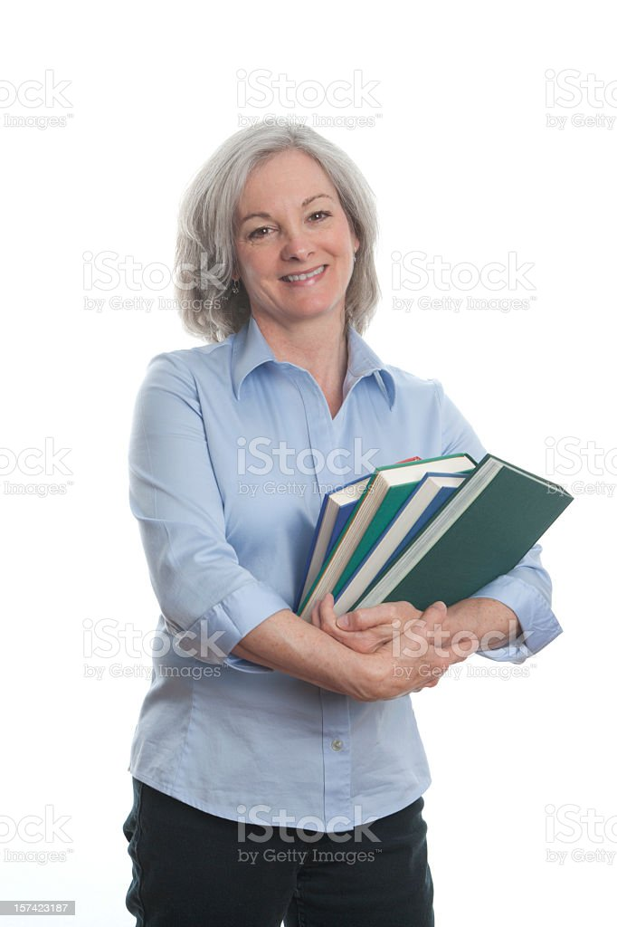 Woman wearing blue shirt clutching books royalty-free stock photo