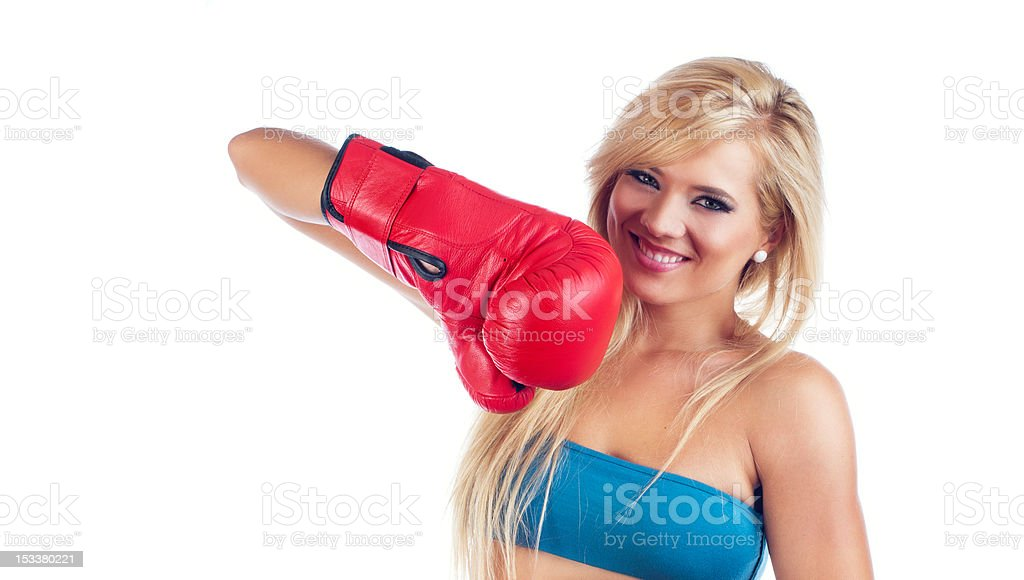 Woman wearing boxing glov stock photo