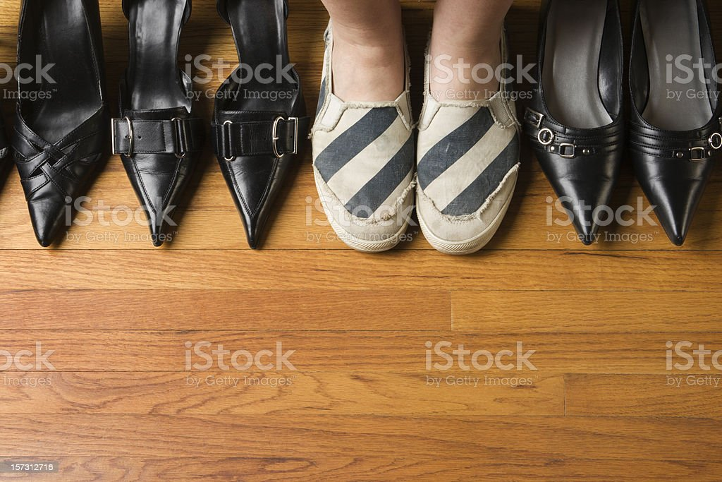 Woman Wearing Comfortable Sports Shoes with Dress Heels Variety Selection stock photo