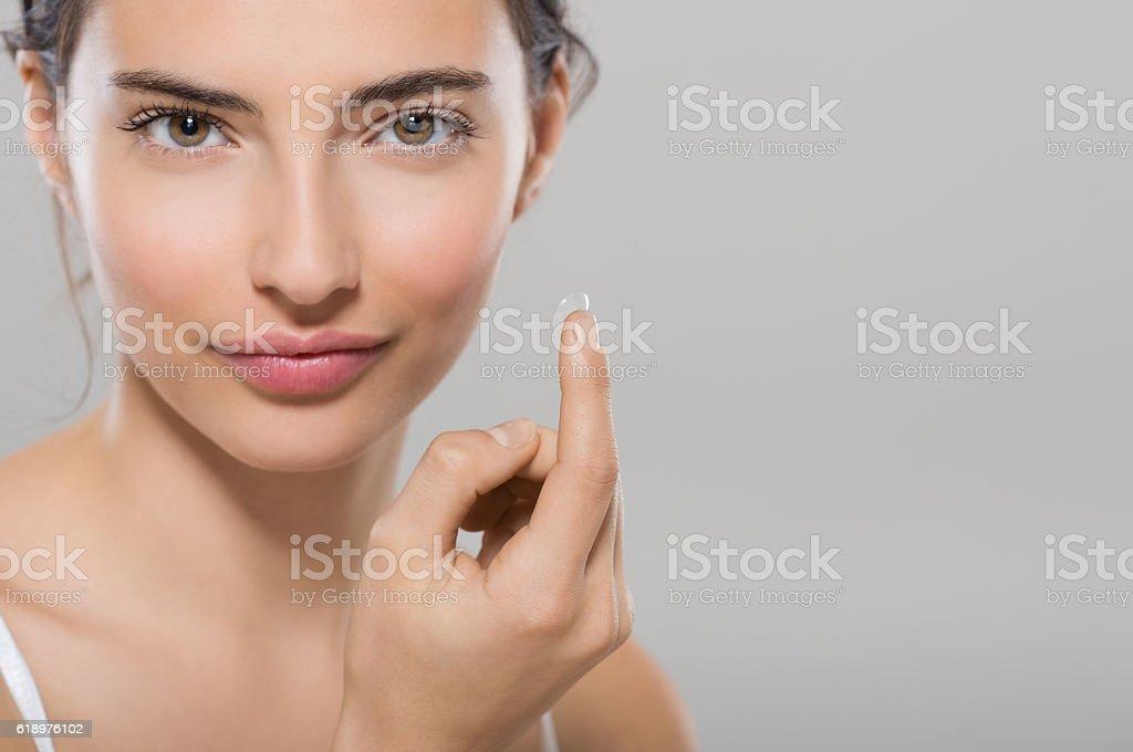 Woman wearing contact lens stock photo