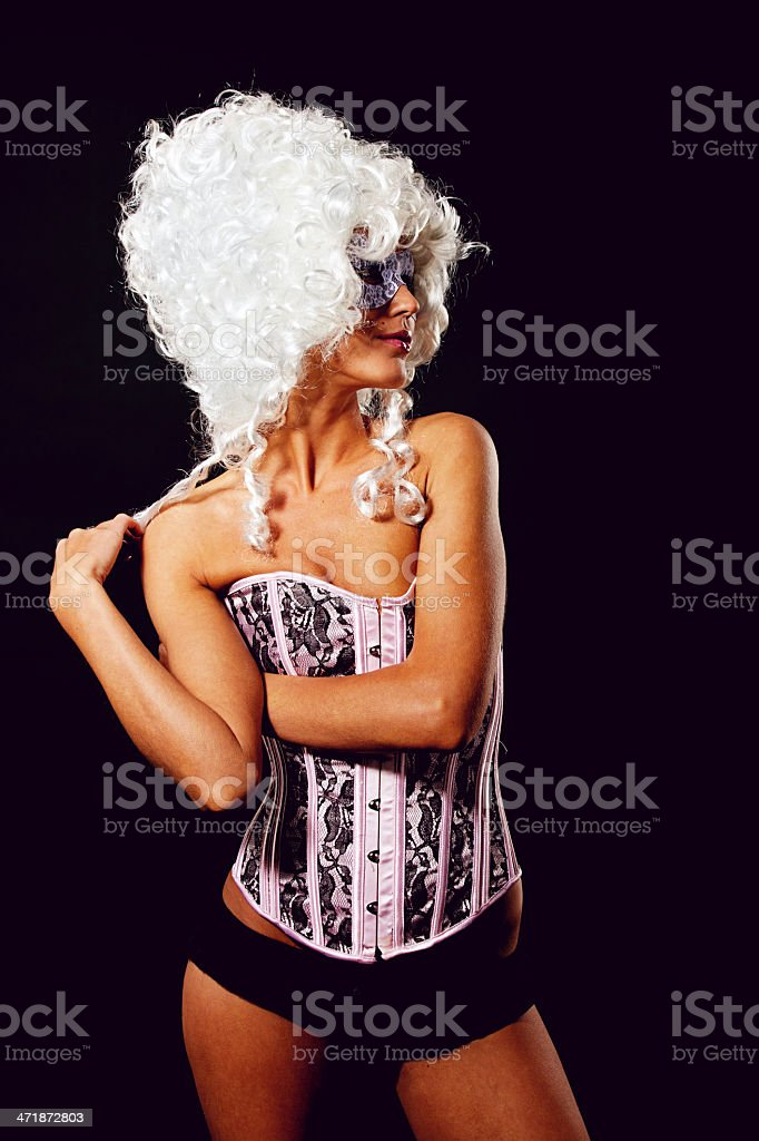 Woman wearing curly white wig with mask royalty-free stock photo