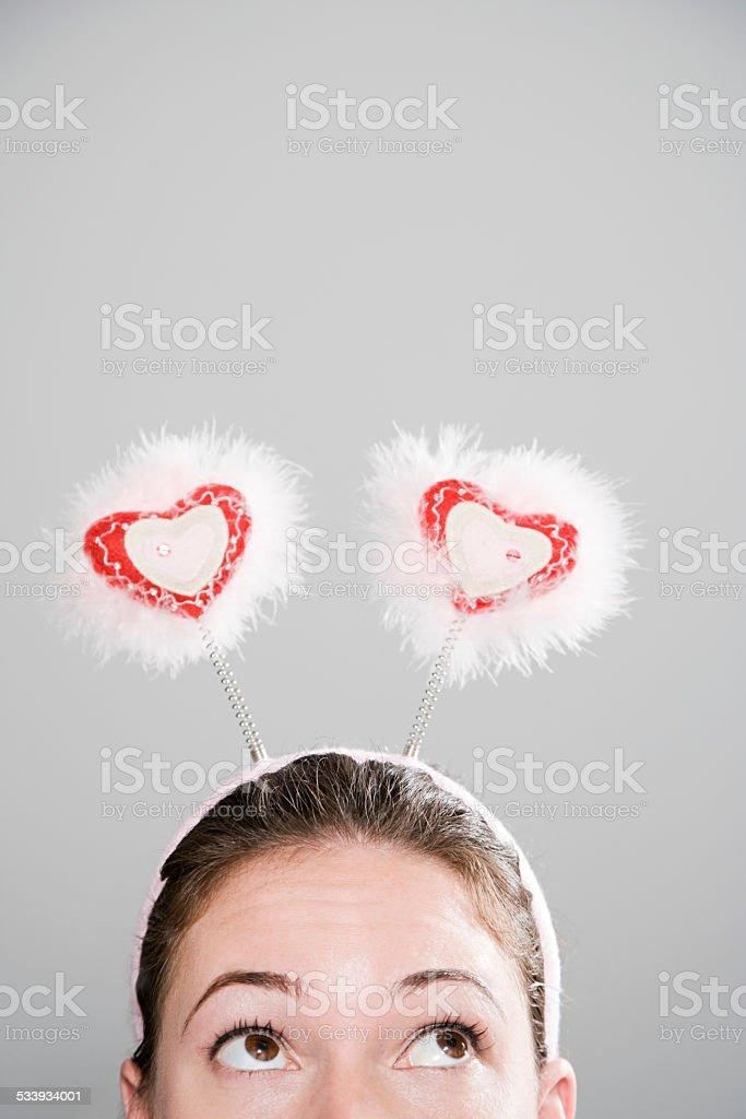 Woman wearing deely bopper stock photo