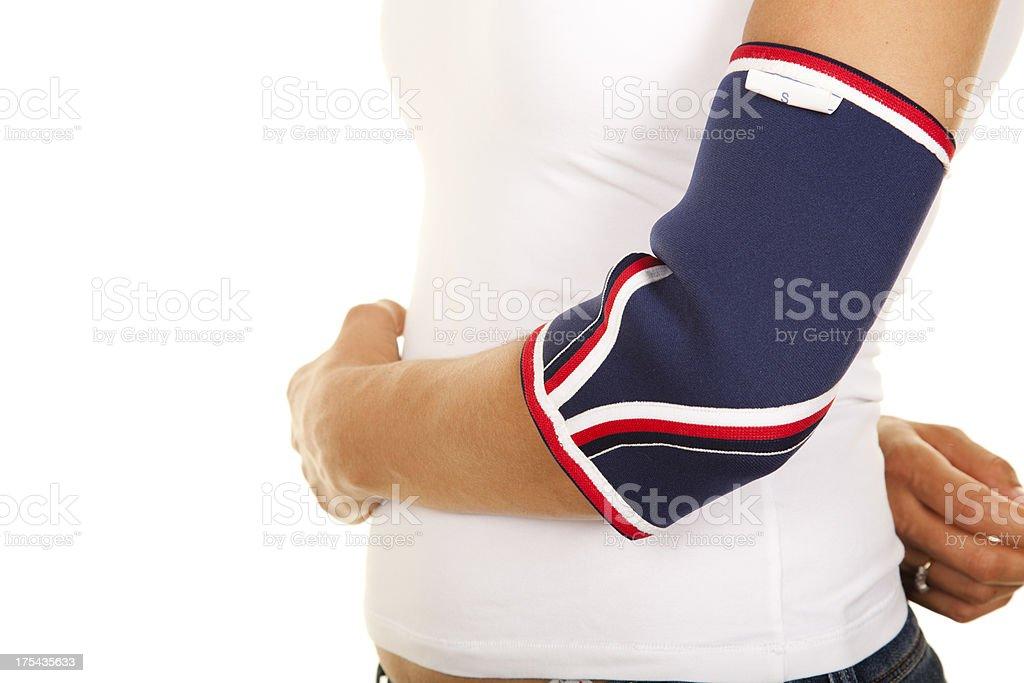 Woman Wearing Elbow Brace stock photo