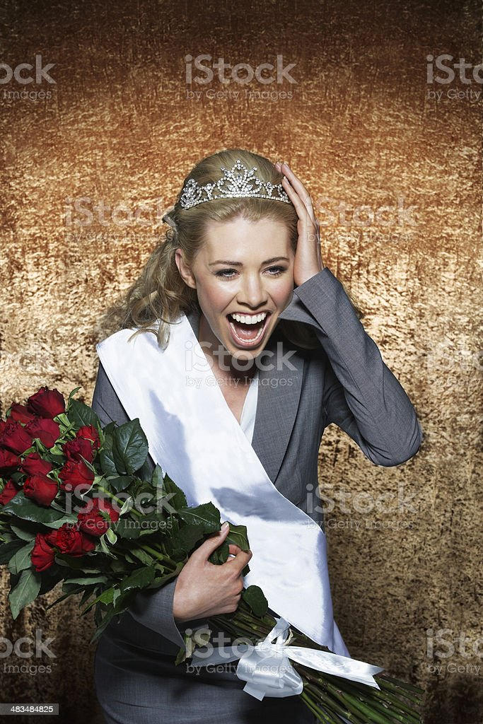 Woman Wearing Employee Of The Month Crown stock photo