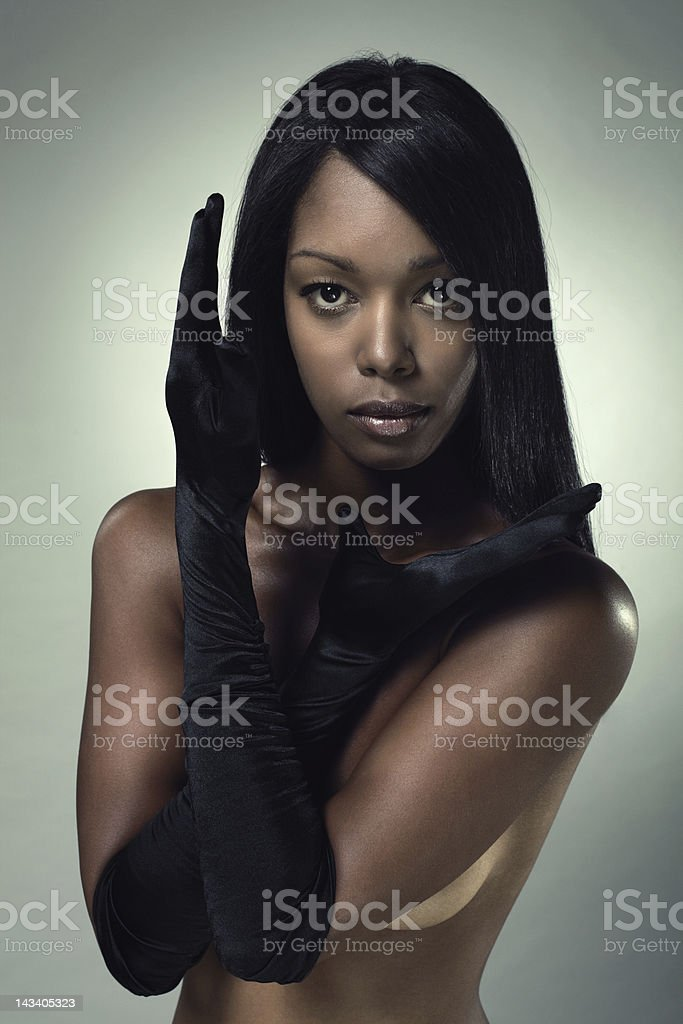 Woman wearing evening gloves. royalty-free stock photo