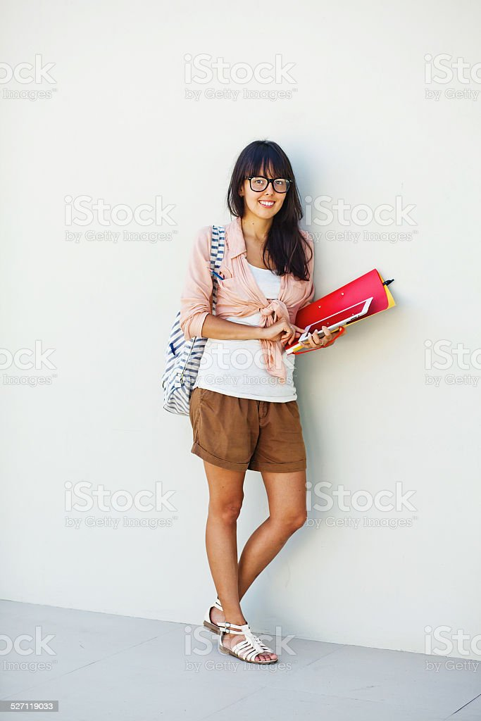Woman wearing eyeglasses with tablet and folders stock photo
