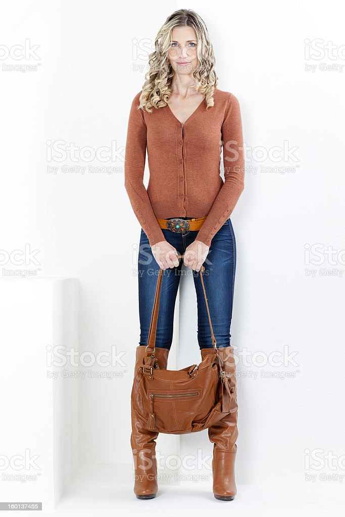 woman wearing fashionable brown boots royalty-free stock photo
