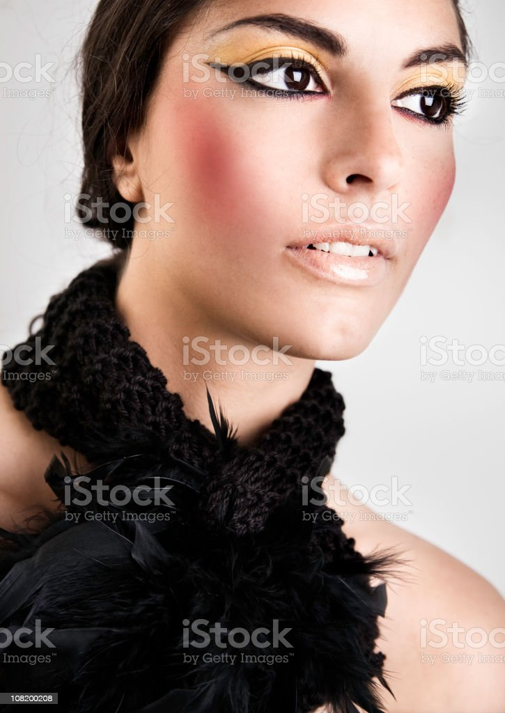 Woman Wearing Feather Necklace and Make-Up royalty-free stock photo