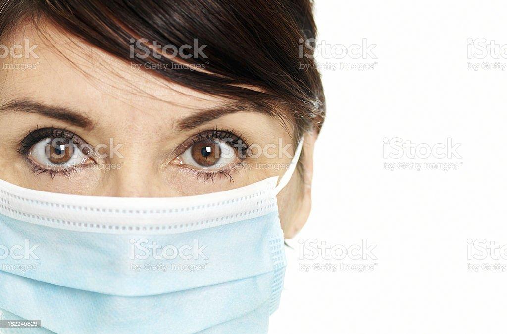 Woman wearing flu mask royalty-free stock photo
