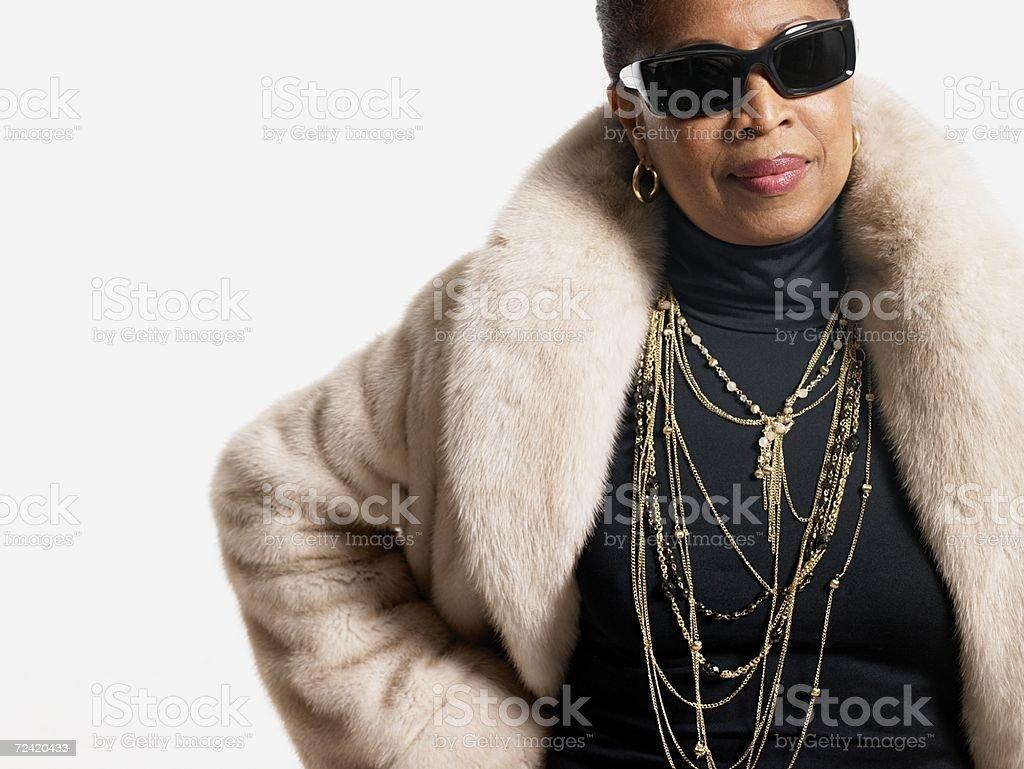 Woman wearing fur coat and jewelry stock photo