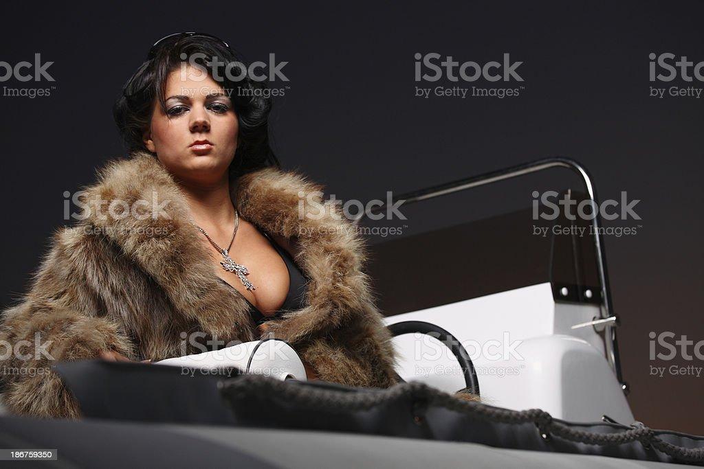 Woman wearing fur coat royalty-free stock photo
