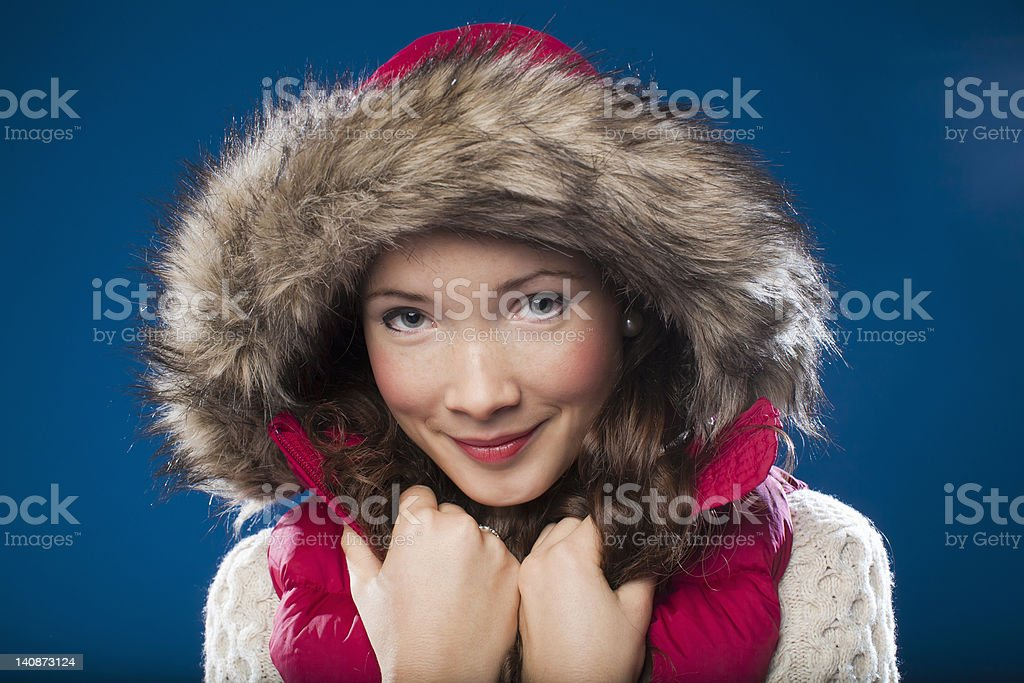 Woman wearing fur-lined parka stock photo