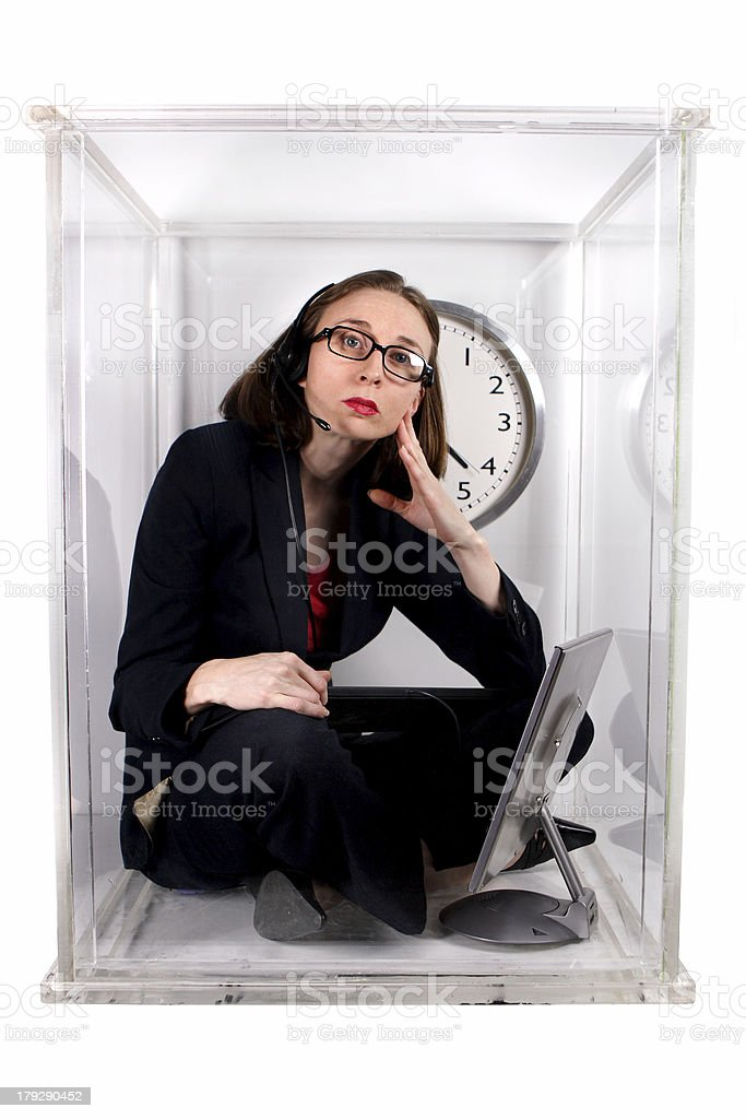 A woman wearing glasses inside of a small box stock photo
