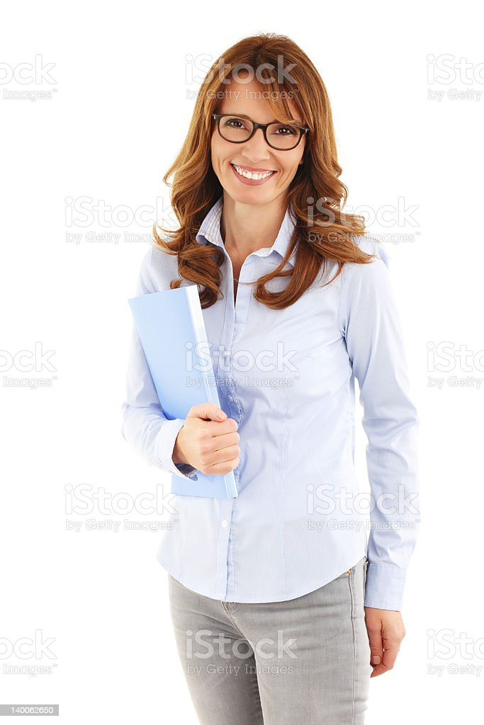 Woman wearing glasses smiling and holding a folder stock photo