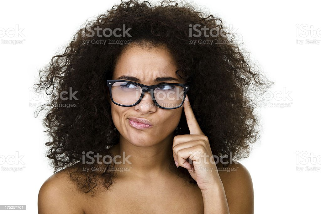 Woman wearing glasses thinking royalty-free stock photo