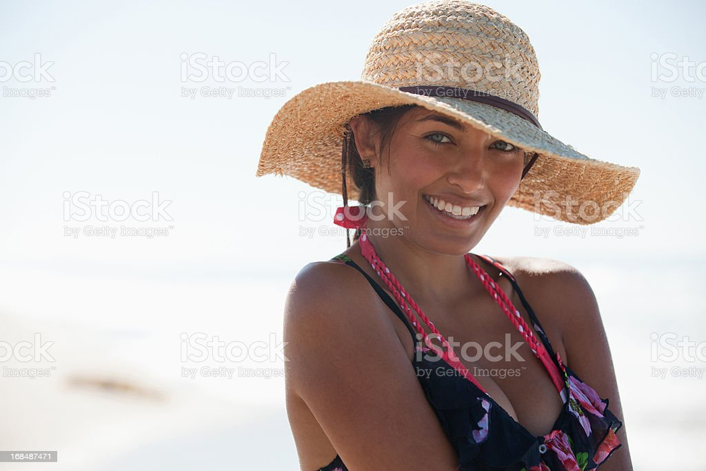 Woman wearing hat on beach royalty-free stock photo