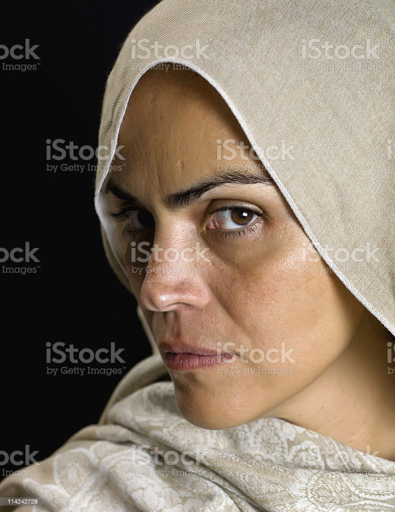 Woman Wearing Hijab Staring into the Camera Defiantly stock photo