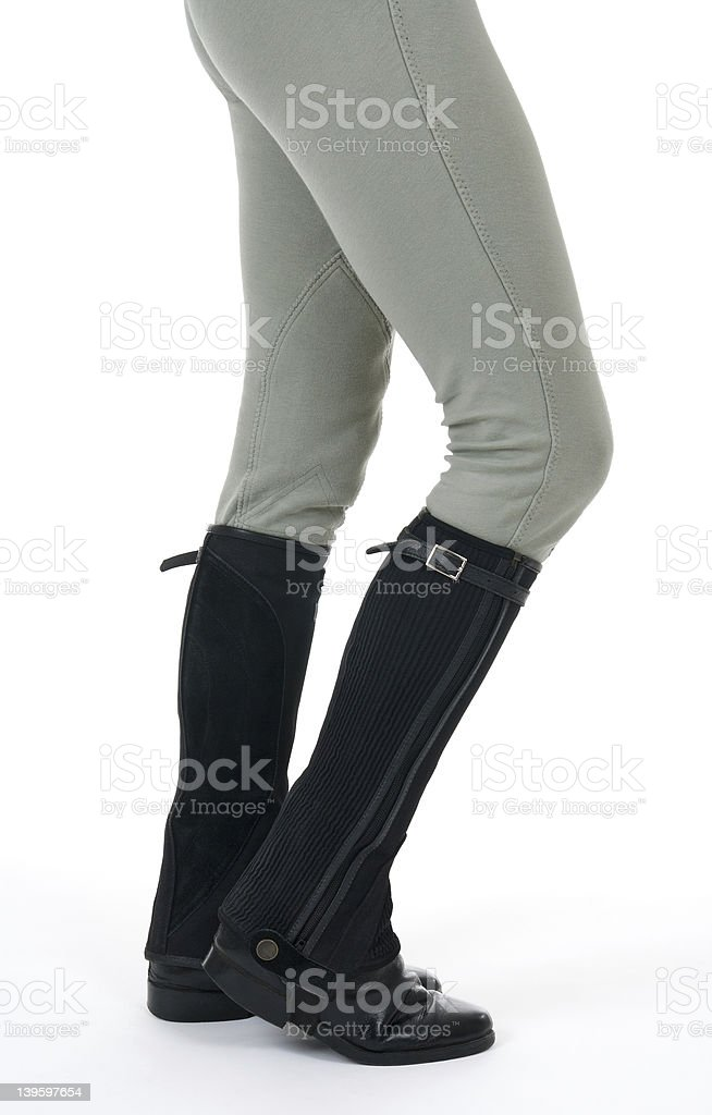 Woman wearing horse riding boots and breeches stock photo
