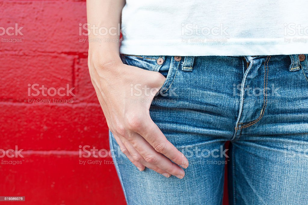 Woman wearing jeans stock photo