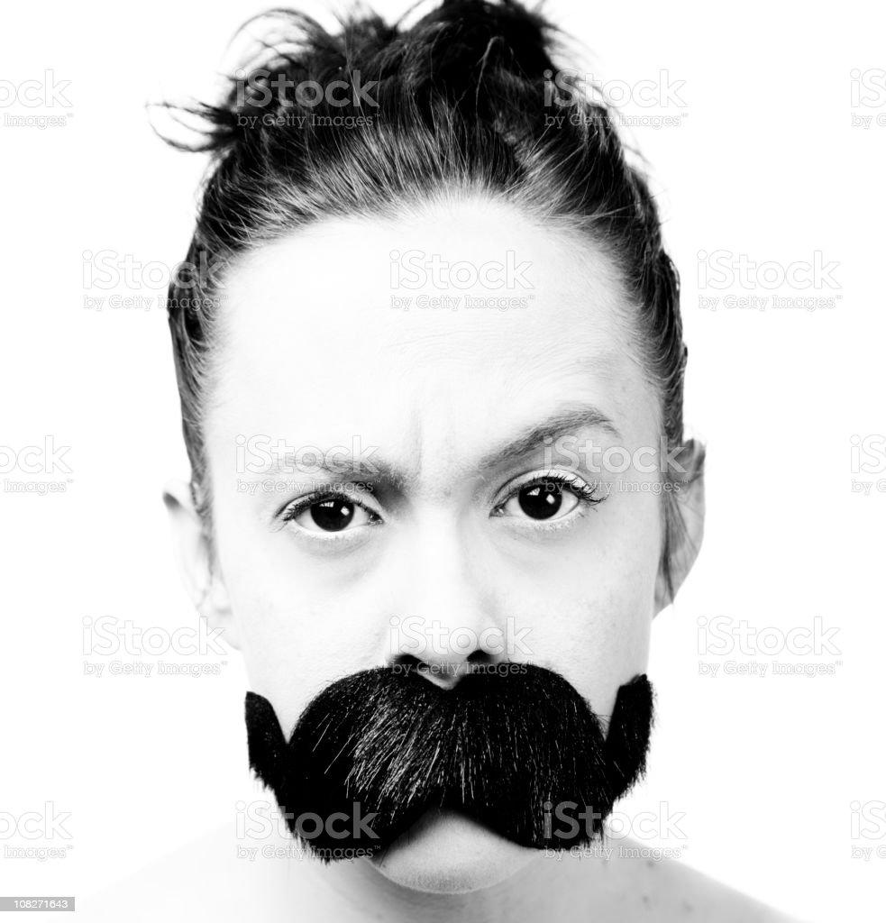 Woman Wearing Large Fake Moustache stock photo